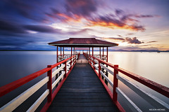 Pitas red jetty (Nelson Michael) Tags: sunset red seascape nature landscape evening landscapes long exposure ray seascapes jetty sony malaysia nd za sabah singh cokin 1635mm pitas a99 sonyalpha rgnd