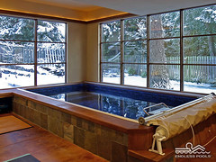 Indoor Endless Pool on a Snowy Day (Endless Pools) Tags: snow swimming indoorpool yearround endlesspools endlesspool indoorlappool