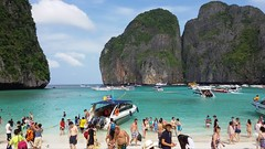 Crowded Paradise (stardex) Tags: sea sky people woman mountain man beach thailand boat sand tourist krabi phiphiislands stardex
