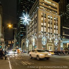 Christmas at 5th and 57th (PC200759) (Michael.Lee.Pics.NYC) Tags: snowflake christmas newyork night traffic motionblur fifthavenue tiffany 57thstreet holidayseason rokinon10mm