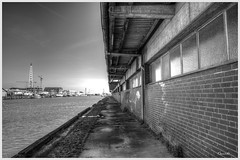Fischereihafen (Onascht) Tags: mole hafen nordsee kran halle hdr weg cuxhaven niedersachsen kutter aufnahme fischereihafen schwarzweis serienaufnahme packhalle