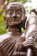 Close-up statue of hiking monk in a Buddhist temple. (diary of moon) Tags: ancient antiques architecture art artistic asia beautiful beauty belief buddha buddhism church concept culture dark decoration decorative east expression faith figure god heritage hiking historic history holy idolatry meditation model monk object old peaceful pilgrim pray prayer reflection relax religion sacred sculpture standing statue style temple thailand tourism traditional tree worship