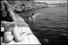(Jumping Jack Splash) (Robbie McIntosh) Tags: leicamp leica mp rangefinder streetphotography 35mm film pellicola analog analogue negative leicam analogico blackandwhite bw biancoenero bn monochrome argentique dyi selfdeveloped filmisnotdead autaut candid strangers leicaelmarit28mmf28iii elmarit28mmf28iii elmarit 28mm arsimagofd arsimagofddeveloper arsimagofd159 seaside rocks fujineopanacros fuji neopan acros woman girl legs feet dive cannonball splash