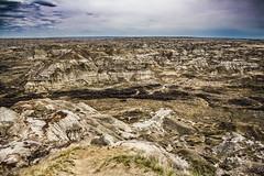 Badland Vista (Stubble Jumper Photography) Tags: nature fossil view dinosaur horizon erosion alberta badlands prehistoric dinosaurprovincialpark westerninteriorseaway cretaceousseaway