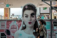We Know Brows (Silver Machine) Tags: london spitalfields oldspitalfieldsmarket windowdisplay poster eyebrows benefitcosmetics lips woman walking streetphotography street candid fujifilm fujifilmxt10 fujinonxf35mmf2rwr