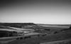 Sunset over Urueña (II) [BW] (Modesto Vega) Tags: urueña wall muralla field campo camposdecastilla wake estela wheat nikon nikond600 fullframe monochrome blackwhite monocromo blancoynegro cardo thistle sunset sprinkler