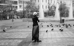 (Georgina ) Tags: blackandwhite monochrome pigeons fountain girl hat square sidewalk athens greece streetphotography portrait candid