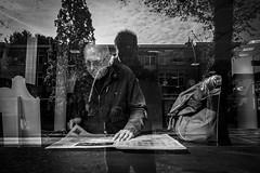 Newspaper and reflections @ Zeist (PaulHoo) Tags: fujifilm x70 2016 window glass reflection mirror selfie bread newspaper read men monochrome bw blackandwhite city citylife people candid streetcandid streetphotography