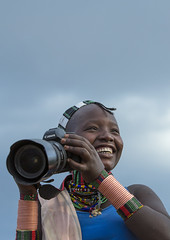 Bashada Tribe Girl Taking Pictures Withn A 5D Canon, Dimeka, Omo Valley, Ethiopia (Eric Lafforgue) Tags: africa camera people smile smiling vertical canon hair outdoors women day african tribal bracelet omovalley braids ethiopia tribe hairstyle anthropology hamar oneperson developingcountry braid hamer braided hammar hornofafrica ethiopian eastafrica thiopien etiopia ethiopie etiopa onewomanonly colorpicture oneyoungwomanonly  dimeka turmi etiopija africanethnicity 1people ethiopi indigenousculture  africanculture onlywomen etiopien etipia  etiyopya  southethiopia colourpicture    omorivervalley      oneteenageronly oneyoungadultonly ethio1402826