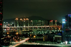 (bill bold II) Tags: longexposure film 35mm nightshot busan southkorea haeundae homedeveloped olympusom2n fujims100100 fujixpressc41