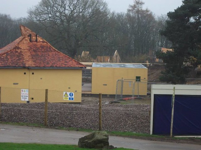 29/11/14 - The lodge on the right is yet to have its roof installed.