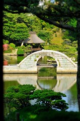 Bridge framed by trees (the.bryce) Tags: japan hiroshima shukkeiengarden