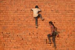 Kids on Brick (Bhaskar Dutta) Tags: red india playing brick kids children kid play indian kiln gujarat