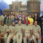 Students and inmates from a local prison pose for a photo