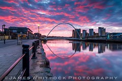 Gateshead Bridge (James Whitlock Photography) Tags: uk bridge sky colour sunrise canon reflections river newcastle colorful illuminated gateshead tokina 7d striking