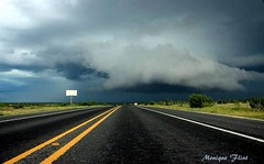 Road to the Storm (moniquef123) Tags: road sky storm green nature weather clouds landscape texas ominous weatherphotography therebeastormabrewin