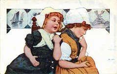 Antique Postcard - Two Little Dutch Girls (Brynn Thorssen) Tags: pictures blue girls red two holland water netherlands windmill dutch hat vintage hair boats whispering sitting dress little antique finger postcard young hats listening dresses thinking sharing thumb talking redhair seated secrets bluedress whitehat orangedress gossiping