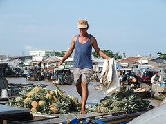 The Right Balance (MarcelineAT93) Tags: travel man boat asia market floating vietnam