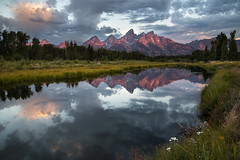 Banner of the Heavens (courtney_meier) Tags: grandtetons grandtetonnationalpark schwabacherlanding dawn sunrise summersunrise reflections reflection wildflowers flowers snakeriver slough clouds mountains grandteton rockymountains northernrockies alpenglow