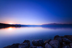 Let the Day Shine Again (Maximecreative) Tags: select lake leman lausanne longexposure sunrise sun light glow rise morning shine rocks mountains alps blue orange switzerland explore reflection mirror landscape canon6d wideangle water sky
