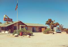 end of the trail (Maureen Bond) Tags: motel desert ca mojave maureenbond flag pole american sign car wagon classic vintage dirt brush