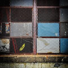 Cuidado... (tim.perdue) Tags: cuidado caution tape window metal grate screen panes color rust concrete sill pattern texture yellow blue columbus ohio urban decay franklinton