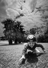Stealth (duncan_mclean) Tags: park boy portrait blackandwhite bw kids children kid child reserve son crawl cambria creep roo stealthy samyang14mm