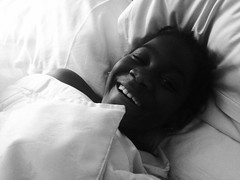 Funny Black Girl Sleeping in White Sheets Hotel Bed Toronto Black and White (stevendepolo) Tags: family sleeping vacation white toronto black girl hotel bed funny sheets lourdie 201415