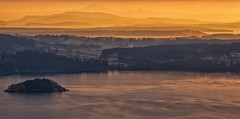 Overlooking Saanich Peninsula, Mt Baker and the Olympic Mountain Range (Freshairphotography) Tags: ocean light orange sun sunlight mist canada mountains cold ice nature colors beautiful beauty misty sunrise canon island volcano coast amazing colorful quiet bc view relaxing peaceful vancouverisland views inlet layers serene oranges sunrays extraordinary mtbaker brentwoodbay mountainrange northsaanich lowcloud olympicmountainrange beautifulbc saanichpeninsula canon7d layersonlayers janismorrisonfreshairphotography