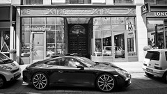 Money on wheels (Playing_with_light) Tags: city bw money black car germany nikon downtown deluxe parking hamburg wheels porsche transportation storefront stores d800 upscale