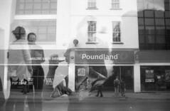 Poundland drinking (Jim Davies) Tags: blackandwhite film monochrome doubleexposure boingboing analogue serendipity expired cosmicsymbol 125asa olympus35dc filmswap filmfilmforever