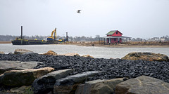 Dredging Near the Shack (Bob Gundersen) Tags: ocean park old winter red sea usa house building water stone architecture port marina outside coast harbor boat photo interesting sand nikon flickr ship waterfront image shots connecticut sandy shoreline picture newengland ct places anchorage madison rainy shore wharf infrastructure shanty historical shack scenes gundersen longislandsound guilford conn towndock nikoncamera d600 lisound grassisland nikond600 glct guilfordlandconservationtrust bobgundersen grassislandshack robertgundersen