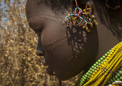 Topossa Woman Earrings, Omo Valley, Kangate, Ethiopia (Eric Lafforgue) Tags: africa portrait people haircut beauty horizontal closeup female outdoors photography necklace women day pattern adult symbol african decoration earring jewelry tribal jewellery ear blackpeople bead omovalley ritual earrings ethiopia tribe ethnic hairstyle scar marking chin beaded beautifulpeople scars anthropology cultural scarification bravery oneperson jewel developingcountry indigenous labret courage ethnicity onepeople adornment primitive hornofafrica ethiopian eastafrica traditionalclothing blackskin beadednecklace onewomanonly colorpicture oneyoungwomanonly africanethnicity 1people indigenousculture africanculture ethnicgroup onlywomen bodyadornment colourpicture kangate oneadultonly ethio1404668