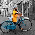 Yellow coat, blue bike thumbnail