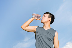 Thirsty athlete drinking water after workout (ake1150sb) Tags: park summer man male water sport training asian bottle athletic healthy holding energy power adult exercise drink masculine muscular young lifestyle fresh listening tired sweat leisure strength practice exhaustion activity athlete workout jogging fitness thirsty fit exhausted active refreshment hydrate