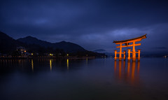 Floating Torii Gate (ErikFromCanada) Tags: longexposure travel blue sunset orange cloud mountain storm mountains reflection water beautiful beauty japan fog night clouds dark landscape japanese lights reflecting evening coast lowlight gate waterfront cloudy outdoor foggy dramatic floating wideangle stormy ridge reflect late ultrawide torii likeamirror smoothwater floatinggate a7r