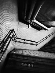(Jon-F, themachine) Tags: urban blackandwhite bw monochrome station japan asian asia olympus monochromatic hallway trainstation nagoya  nippon japo grayscale oriental orient fareast  aichi bnw nihon hallways omd stations passageway    chubu japn  2016 nocolor passageways m43  mft  mirrorless  chuubu   micro43 microfourthirds  ft xapn jonfu  mirrorlesscamera snapseed   em5ii em5markii