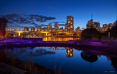 VPD Glow (Clayton Perry Photoworks) Tags: blue canada skyline night vancouver reflections lights bc police falsecreek explorebc explorecanada