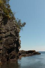 Hanging On (Karen_Chappell) Tags: ocean blue trees sea seascape canada green water newfoundland landscape coast scenery rocks scenic rocky atlantic shore nfld atlanticcanada baulineeast avalonpeninsula