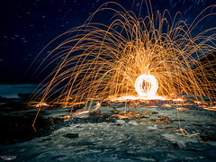 Burning Trails (Laith Stevens Photography) Tags: longexposure winter sea lightpainting wool rock waves steel ngc olympus sparks startrails autofocus omdem1 1240mmf28