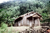 32-254 (ndpa / s. lundeen, archivist) Tags: rural village people nick dewolf nickdewolf 32 reel32 color photographbynickdewolf 1970s 1972 fall film 35mm winter republicofchina taiwan taiwanese eastcoast easterntaiwan hualien hualiencounty easterncoast rurallife unidentified building buildings house houses home homes thatchroof thatchedroof cross church hill hillside mountain mountainside hills mountains china chinese 1973