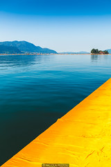 Yellow corner (Nicola Pezzoli) Tags: blue summer italy lake mountains art nature water colors yellow canon reflections island design san paolo piers floating calm bergamo brescia lombardia christo iseo sulzano
