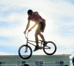 Sun Bike Roof (Rose*Bud) Tags: bike biker roof stunt sun air aerial beach boardwalk summer nj