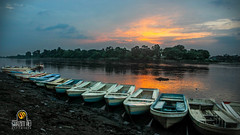 On the Bank of river... (Shazim Butt) Tags: blue pakistan sunset sky reflection tree nature water colors river boats photography ravi shade lahore shazim