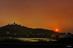 Sunset over Thiruthani Temple (Lavs.) Tags: sunset thiruthanimurugantemple thiruthani murugan temple 2009 landscape nikonclicks nikond7000 lake highwayphotography