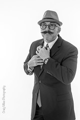 """""""I'm always in disguise, in one form or another."""" (MrPessimist) Tags: portrait bw selfportrait hat glasses blackwhite nikon tie suit strobe alienbees suittie strobist ab800 d7100 ab400 nikond7100"""