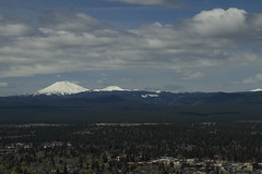 View from lookout over Bend and the surrounding mountains, Oregon (Anna Calvert Photography) Tags: city trees sky snow mountains nature clouds oregon forest scenery view unitedstates bend lookout hills mtwashington snowcapped mtjefferson threesisters spruce brokentop northsister blackbutte middlesister blackcrater mtbatchelor awreybutte threefingeredjackmountains