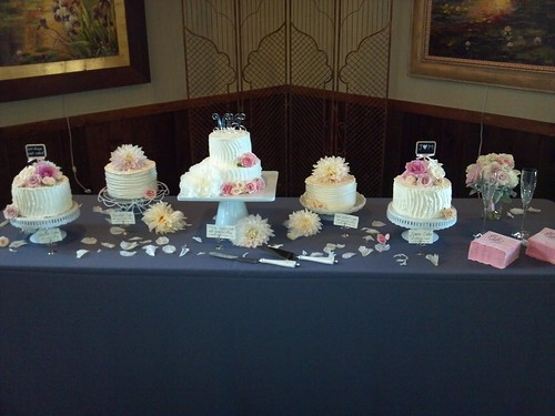 """A wedding cake table of different flavors of small cakes. • <a style=""""font-size:0.8em;"""" href=""""http://www.flickr.com/photos/50891271@N03/16160497828/"""" target=""""_blank"""">View on Flickr</a>"""