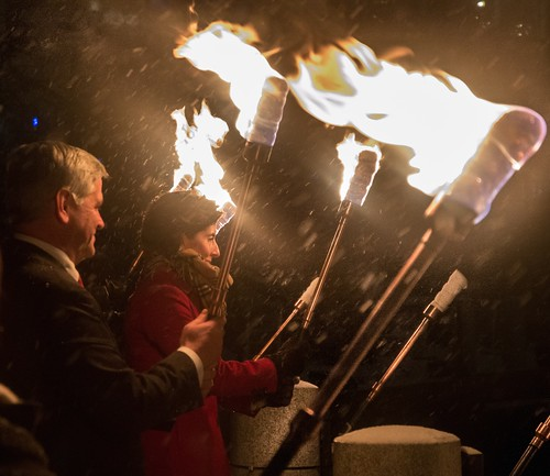 Lt. Governor Dan Mckee and Governor Gina Raimondo hold torches during the WaterFire Lighting Ceremony. Photo by Jen Bonin.