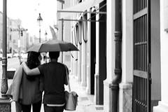 Umbrella hugs (Gulius Caesar) Tags: street umbrella canon munich eos rebel couple t2i